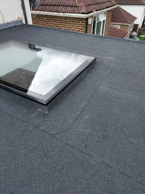 New flat roof and sky light installation