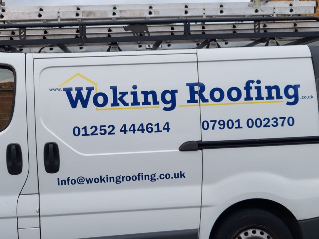 woking roofing van with signage